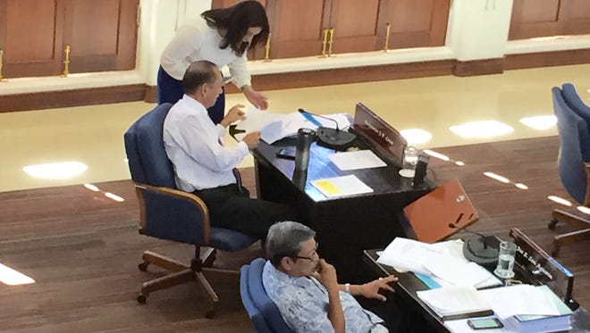 Sen. Telena Nelson confers with Speaker Benjamin Cruz on Wednesday, the third day that senators tackled a bill that would allow the Port Authority of Guam to borrow up to $80 million on the bond market.