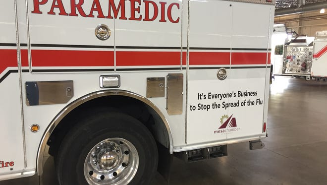 The first sponsored firetruck in Mesa includes a safety message about the flu and the logo of the Mesa Chamber of Commerce.