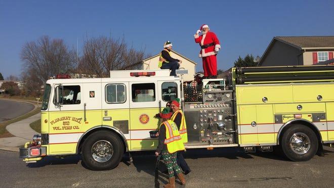 Pleasant Hill Volunteer Fire Company escorts Santa Claus around Hanover neighborhoods on December 3, 2017.