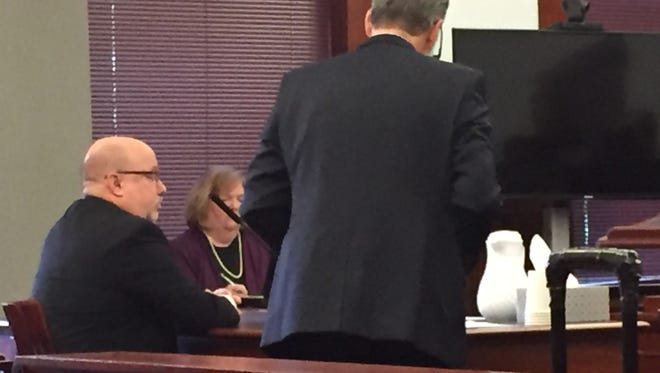 Bruce Davidson, left, during his sentencing hearing Monday in Cascade County District Court.
