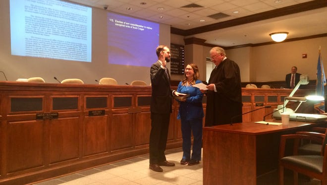 New Jackson City Councilman Ross Priddy is sworn in by City of Jackson Judge Blake Anderson Tuesday morning at City Hall.
