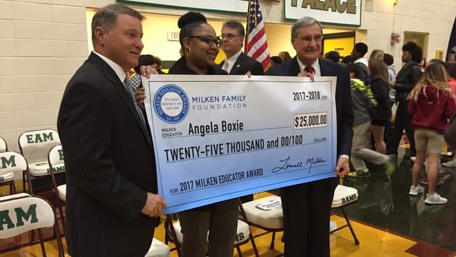 Angela Boxie received a Milken Educator Award Thursday. She is seen here with State Sen. Page Cortez, left, and Lafayette Parish Superintendent Donald Aguillard.
