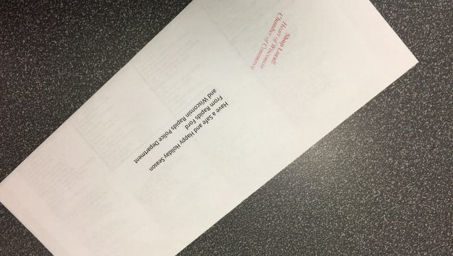 One of 60 envelopes containing a $50 gift certificate handed out to drivers during the holiday season.