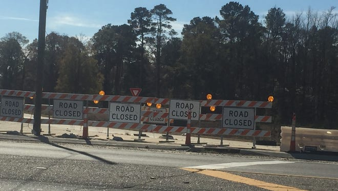 Road Closed signs blocking off an interstate ramp along I-49.