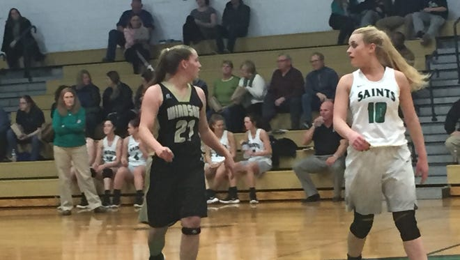 Seton Catholic Central's Ava McCann, right, and Windsor's Hanna Hagerman led their respective teams in scoring in the host Saints' 82-25 STAC victory Tuesday. McCann had 19 points -- 10 more than Hagerman.