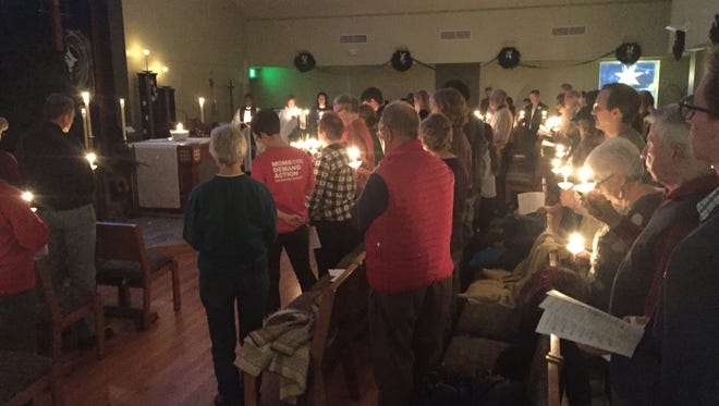 More than 100 attendees gathered for a candlelight vigil for gun violence victims on Dec. 10, 2017 at St. Paul's Episcopal Church in Brighton. Dec. 14 marks the fifth anniversary of the Sandy Hook Elementary mass shooting in which 20 children and six staff members died.