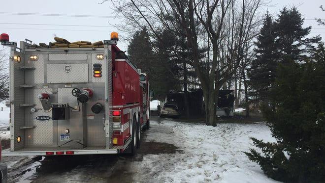 A fire truck sits outside a home where a fire killed a 3-year-old Monday morning in Custer Township.