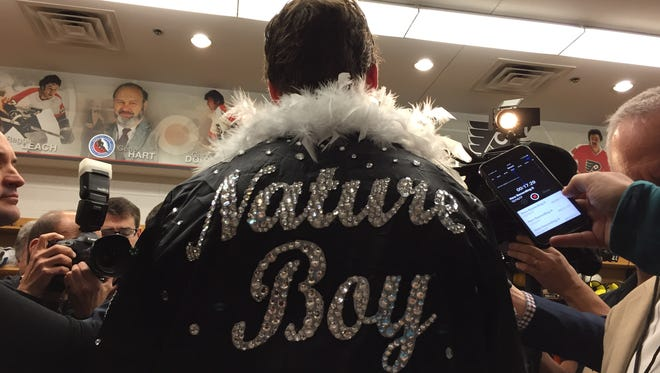 Rookie Travis Sanheim got to wear the Nature Boy robe after scoring his first career NHL goal.