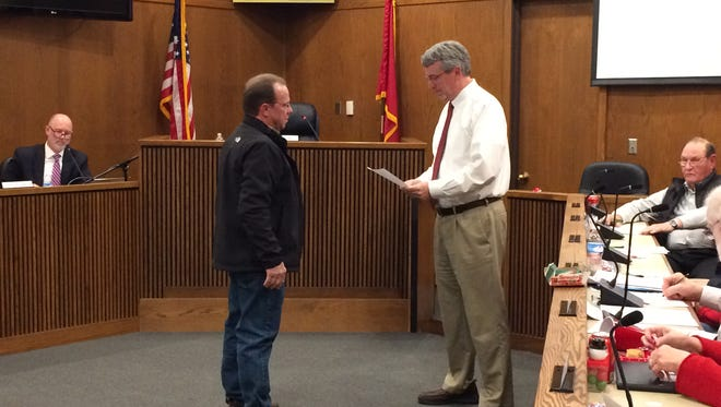 Dwight McIllwain, left, is sworn in as a county commissioner by Dickson County Mayor Bob Rial on Dec. 18.