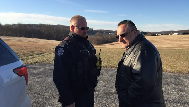 Lower Windsor Township Police Chief Tim Caldwell and York County Detective Doug Demangone talk near the spot off Salem Church Road where human remains were found early Thursday morning.