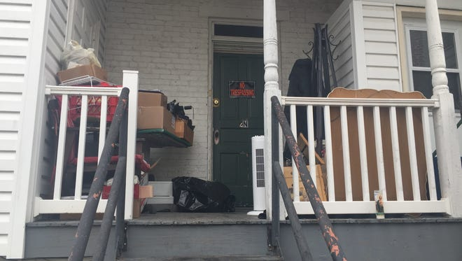 Erin Britt Morrow's back porch at her Gettysburg home and a candle placed outside by a neighbor in remembrance. Morrow was found dead on her porch on Jan. 8.
