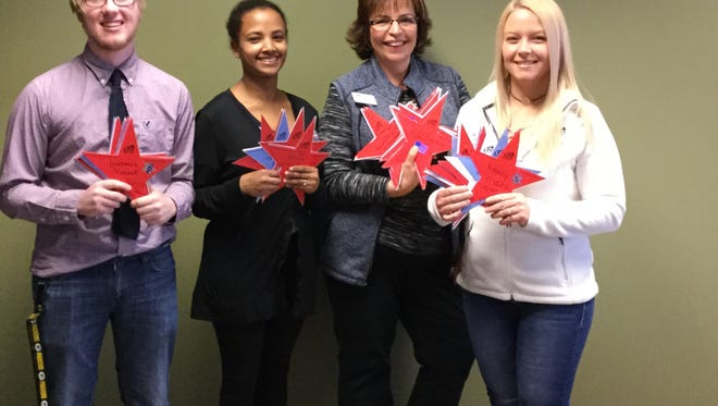 """The Lakeshore Technical College Student Government Association Executive Team recently helped establish the """"Our Stars"""" Scholarship for Student Veterans. Pictured from left: Kyle Pate, SGA secretary; Tsion Purtell, SGA vice president; Tammie Stahl, LTC student engagement specialist/SGA adviser; and Tania Brown, SGA president."""