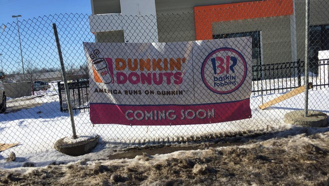 The winter storm delayed construction of the new Dunkin' Donuts on First Avenue. It'll be another month.