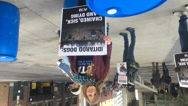 PETA campaigner Tricia Lebkuecher led a group of protesters outside Cobo Center.