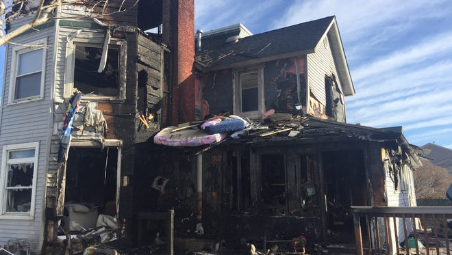 A smoldering cigarette may have started an early Saturday morning blaze on Manahassett Avenue