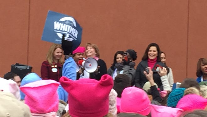 Democratic gubernatorial candidate Gretchen Whitmer, right, of East Lansing, spoke Sunday afternoon before the Women's March in downtown Lansing.