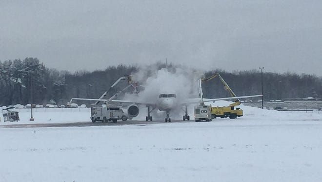 This undated photo provided by the Portland International Jetport shows an aircraft being de-iced.