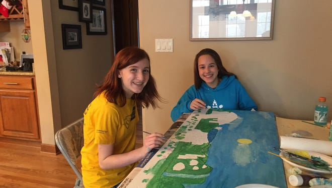 Grace Organ (left) and Margaret Krajnak, two eighth-graders who were on the St. Alphonsus School team that won the 2018 Future City contest, work on building a city from the ground up. The team had to present a model of its future city.