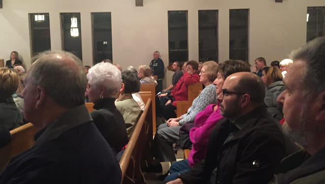 Somerdale residents, sitting in pews at the former Our Lady of Grace Church, hear plans to convert the White Horse Pike property into a mixed-use development.