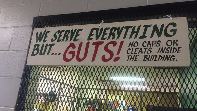 A sign on the door of the equipment room at the Archie Cooley Devil's Den sets the tone for the football program under new head coach Vincent Dancy.