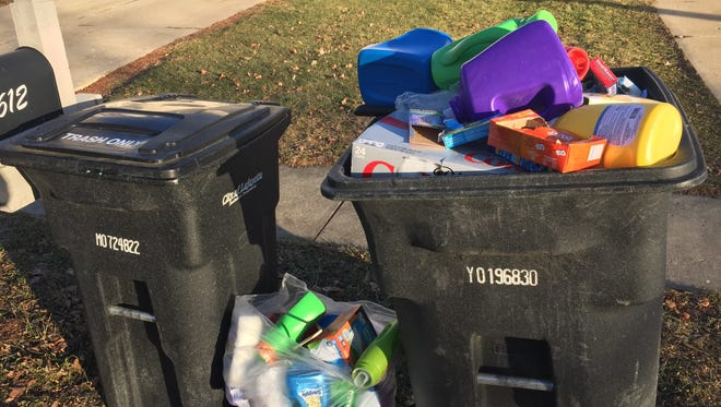 As part of Lafayette's curbside program, the recycling containers are bigger than the trash containers.