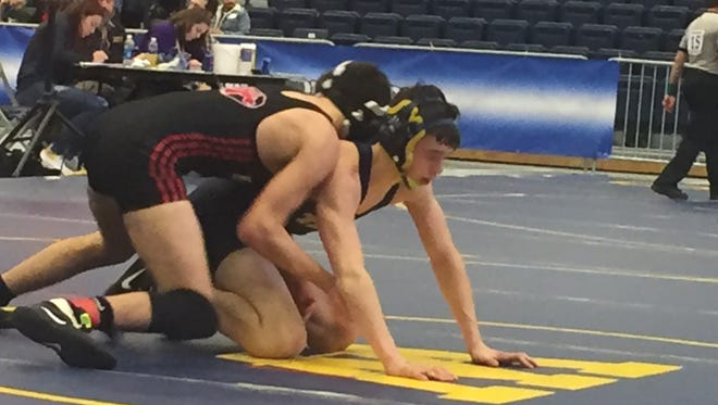 Tioga's John Worthing, bottom, wrestles Mount Sinai's Mike O'Brien in the 120-pound matchh of NYSPHSAA Division II state semifinal Saturday at Onondaga Community College. Worthing won, 8-0, but the Tigers fell, 33-32.