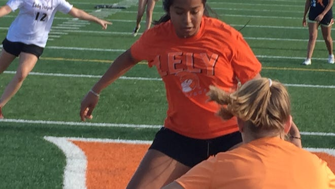 Lely junior standout Alondra Castillo participates in a team drill during practice Tuesday, Jan. 30, at Lely High School. Castillo leads the team with 14 goals and 16 assists. Lely travels to Cape Coral-Mariner on Tuesday, Feb. 6, for its first regional playoff game in a decade.