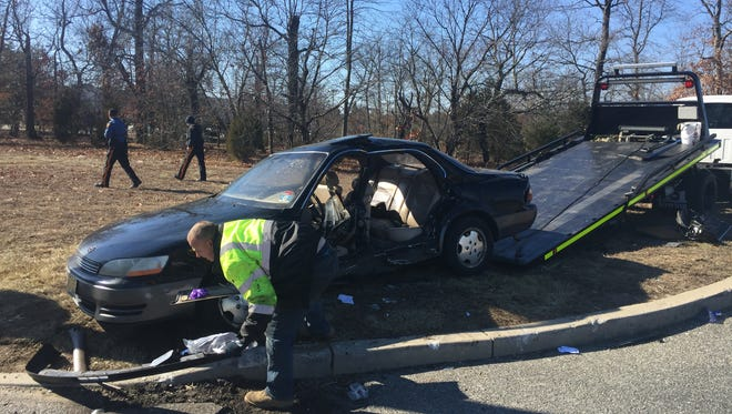 A Millville woman was reported injured in a two-vehicle crash Saturday at Mill and Garden roads in Vineland.