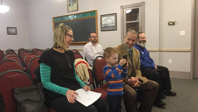 Millville Senior High School Assistant Principal Steve Matusz (seated right) sits with his wife Kristi and son Lincoln just after his appointment Monday night as the next executive director of Special Services for the Millville School District.