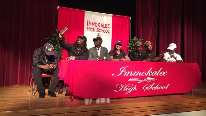Immokalee High School held its National Signing Day ceremony Wednesday, February 9, 2018, at the high school. Six football players and a softball player signed on the dotted line to continue their academic and athletic careers. From left are Clarence Jean (Warner University), Abraham Alce (University of Akron), Shedro Louis (University of Akron), Mercedes Salinas (FGCU), Gonzalez Fleriot (Tusculum College), Malcom Jackson (Tusculum College) and Fred Green (Mercyhurst University).