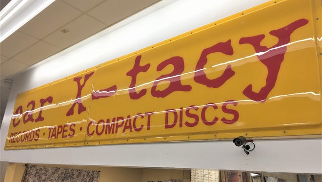 This vintage ear X-tacy sign has popped up at a local Vendors' Village, but it isn't for sale.
