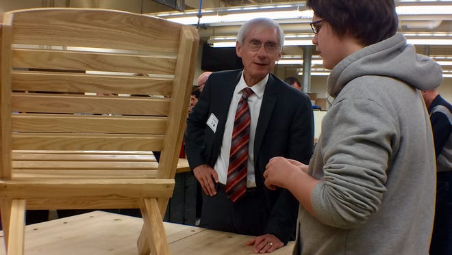 State Superintendent Tony Evers talks with a Little Chute High School student as part of his tour of the school for Career and Technical Education Month.