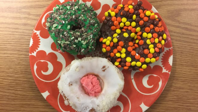 Holey Schmidt Donuts opened Feb. 17 in Reno next door to the Discovery Museum. The donuteria is known for its whimsical and offbeat toppings and flavors.