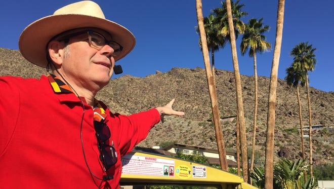 Charles Phoenix points to the Albert Frey hillside house on a doubledecker tour during Modernism Week.