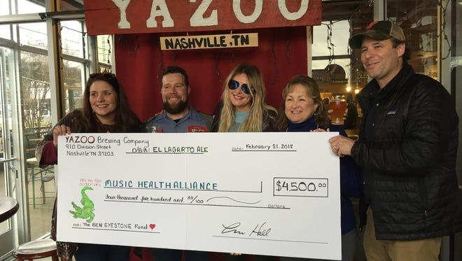 Left to right: Tatum Allsep of Music Health Alliance, Ivan Chester of Yazoo, musician Elizabeth Cook, Shelia Shipley Biddey of MHA and Linus Hall, founder of Yazoo Brewing. Yazoo and Cook raised $4,500 for MHA's Ben Eyestone Fund.
