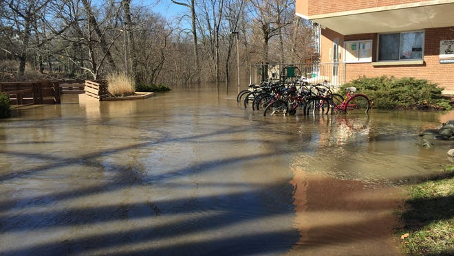 Water surrounds the MSU Bikes Service Center Thursday, Feb. 22, 2018.