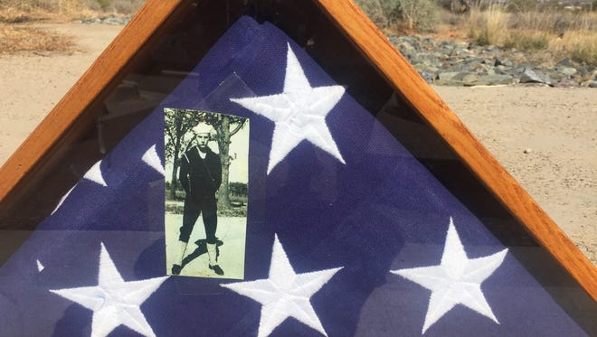 Donna Dewberry found this burial flag and photo near a dumpster at a Phoenix apartment complex on Feb. 18, 2018. She is using Facebook to try to return it to the family.