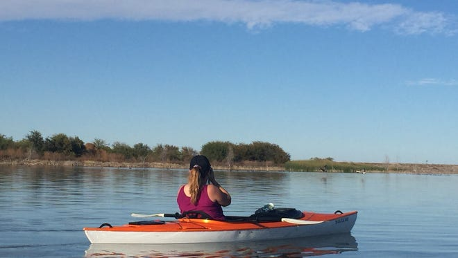 Texas Master Naturalist Megan Sternadel learning more about Lake Arrowhead State Park by kayak.