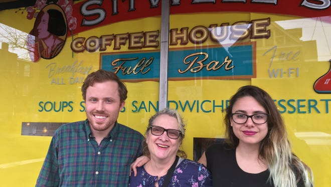 Alex Barden, Lisa Storie and Florencia Garayoa pose outside of Sitwell's Coffee House in Clifton.