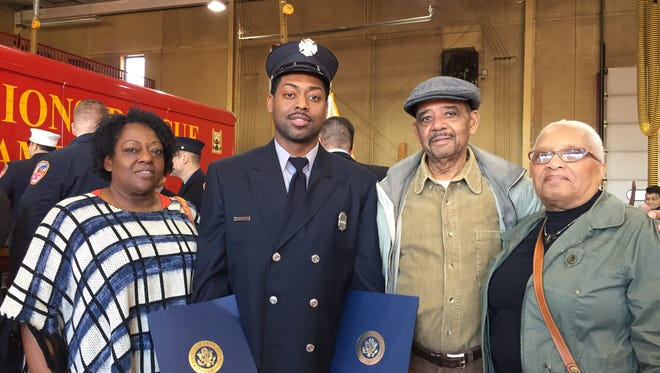 Camden firefighter Milike Winthers stands with his mother, Francine; grandfather Nathaniel; and grandmother Henrietta. Winthers was cited by the department for his heroic actions to save a woman's life.