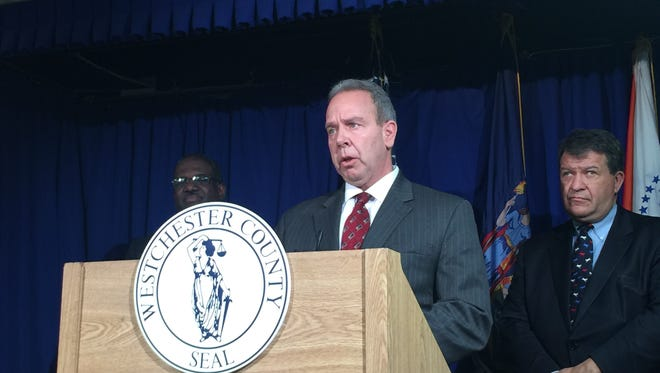Joseph Spano, commissioner of the Westchester County Department of Correction, is introduced at a news conference at the office of County Executive George Latimer, right.