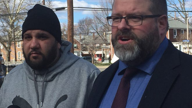 Edward Minguela of Camden and attorney Devon Jacob hold a press conference at the scene of an alleged police assault in the Fairview area.