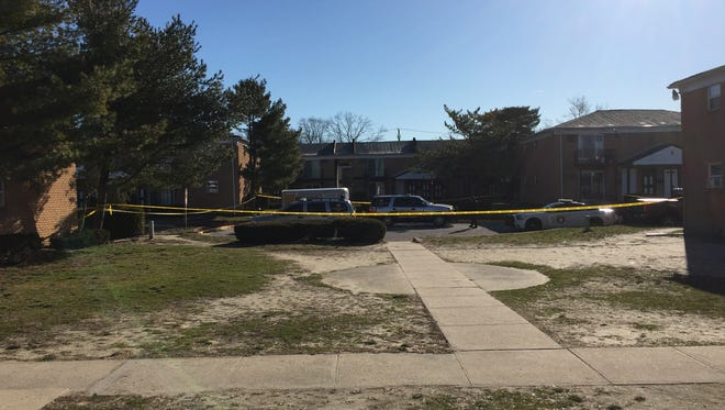Police continued to investigate the morning after a Brick man was shot and killed at the Hampton Gardens apartment complex in Toms River.