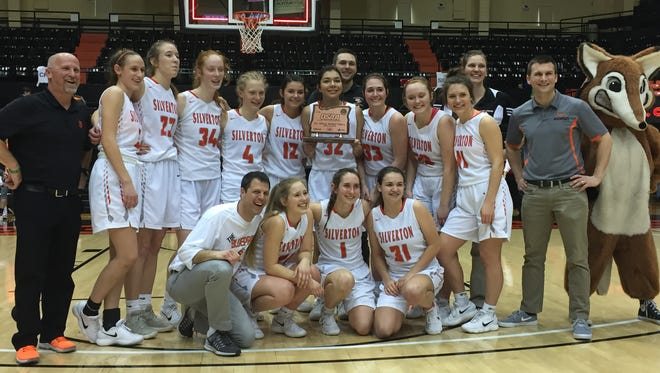 The Silverton girls basketball team defeats Bend in the third-place game of the OSAA 5A state tournament at Gill Coliseum on March 9, 2018.
