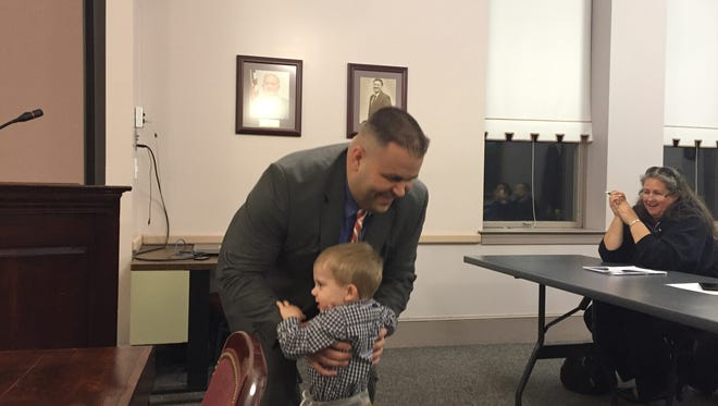 New Millville high school Vice Principal Jason Kessler gets enthusiastic support from his 2-year-old son Gary at Monday night's Board of Education meeting.