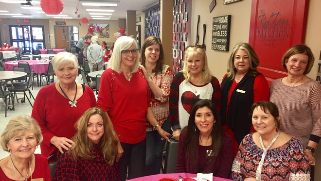 Members of the Senior-Junior Forum volunteered at The Kitchen's Red Door Valentine's Day Party. SJF gives volunteer hours and funds from their annual fundraiser, The Red River Wine & Beer Festival to help support The Kitchen. From left to right back row: Connie Joyce, Lydia McWhorter, Stacey Bailey, Ladell Schmalzried, Sharon Norton, Vicki Tigert, front row, left to right: Loisanne Neal, LaNell Kruger, Pam Hughes and Colleen James