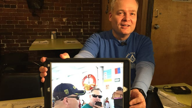 Robert Plank shows a photo from a recent vacation with his partner Grant C. Redmond. Redmond, owner of Acapulco Joe's on Illinois and Vermont streets, was attacked and critically injured outside the restaurant on Tuesday, March 13, 2018.