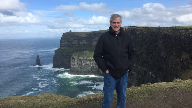 Galion Mayor Tom O'Leary stand Friday along the Cliffs of Moher in Ireland the day before St. Patrick's Day.