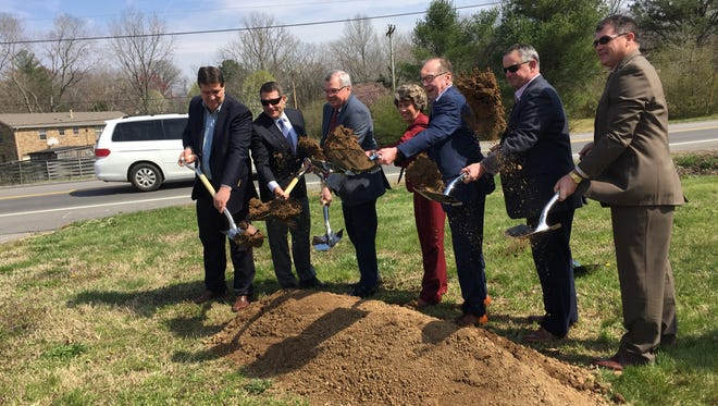 State and local lawmakers gather on State Route 48/13 for a groundbreaking to widen the highway and build a replacement for the McClure Bridge.