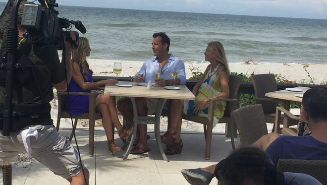 "Crews from HGTV's ""House Hunters"" film with Realtor Heather Caine, left, and Ed McDermott and Lisa Senters-McDermott at Naples Beach Hotel & Golf Club in October 2017."